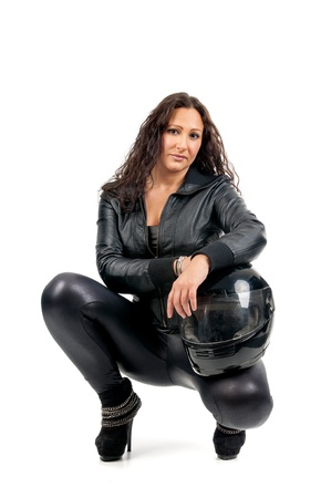 Sexy woman in black with motorcycle helmet