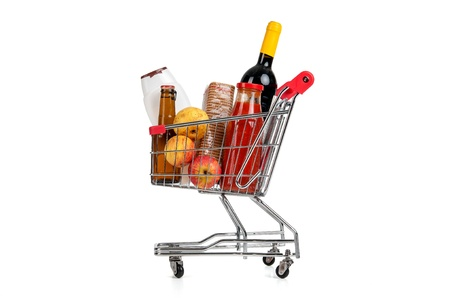 Shopping cart full with groceries isolated in white Stock Photo - 17598465
