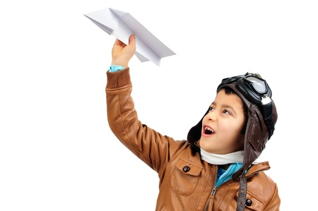 flight helmet: Young boy pilot with a paper plane isolated in white