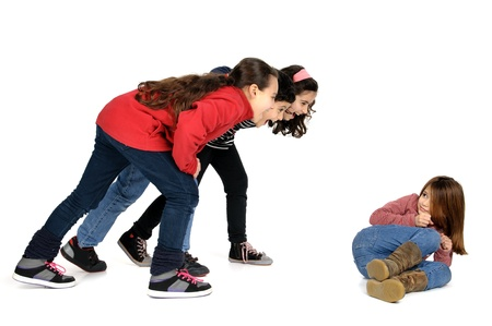 Group of children bullying an isolated child Stock Photo - 17698701