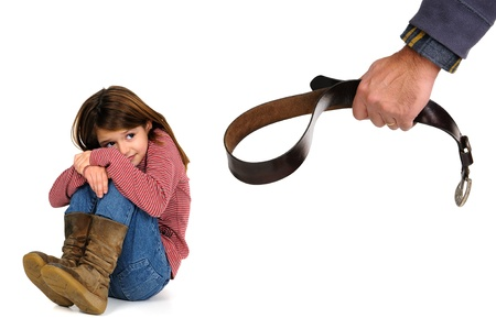 Young girl terrified od her fathers physical punishment with a belt 版權商用圖片