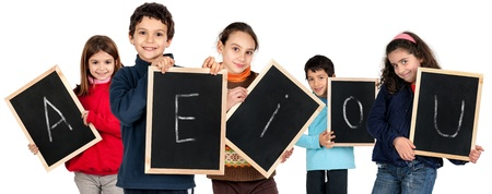 e u: Group of children with black boards and the letters A, E ,I, O, U Stock Photo