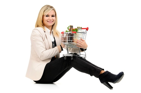 Woman with shopping cart isolated in white Stock Photo - 17926622