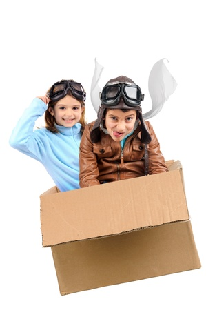 Youngcouple pilot flying a cardboard box isolated in white