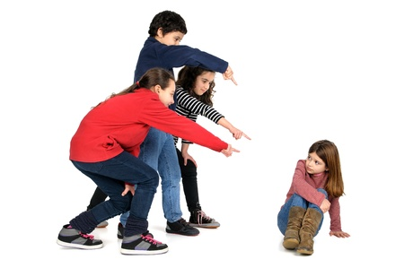 Group of children bullying an isolated child Stock Photo - 18087560