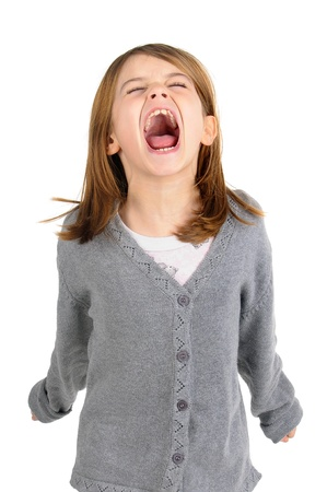 Young girl screaming isolated in white photo