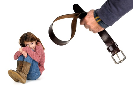 punish: Young girl terrified od her fathers physical punishment with a belt Stock Photo