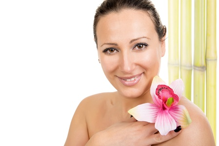 Beautiful woman with flower at beauty spa salon.