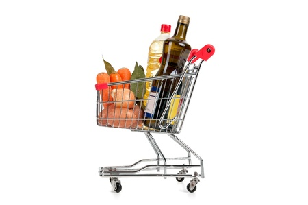 Shopping cart full with groceries isolated in white Stock Photo - 18540069