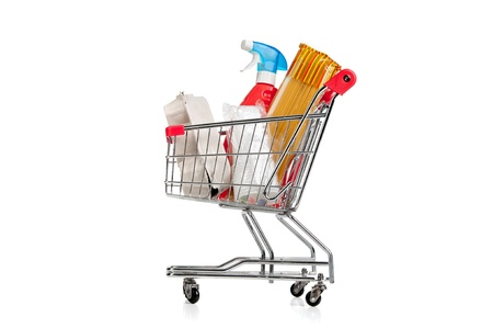 Shopping cart full with groceries isolated in white Stock Photo - 18540055