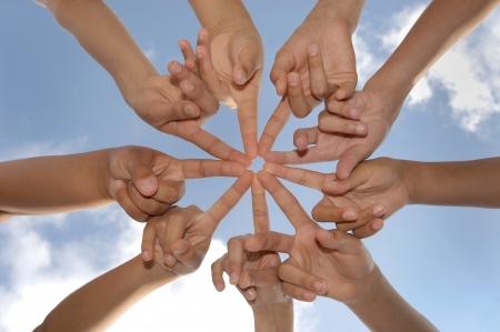 linked: Hands together against the sky