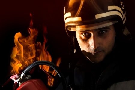 Retrato de un bombero aislado en negro photo