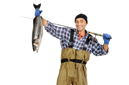 Fisherman posing with the catch isolated in white