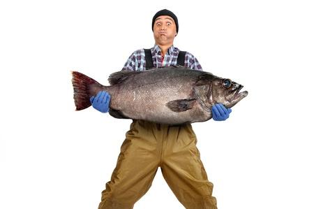 waders: Pescador posando con la captura aislado en blanco