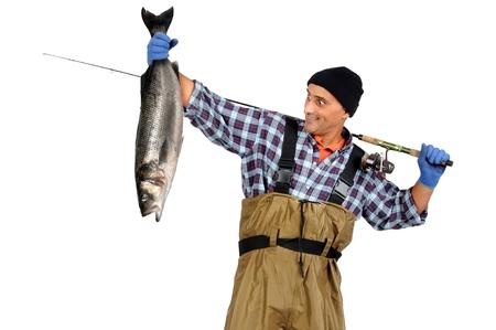 waders: Pescador posando con la captura aislados en fondo blanco Foto de archivo