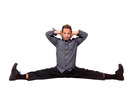 Casual young man doing the splits photo