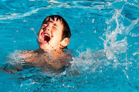 drowning: Young boy playing in the pool