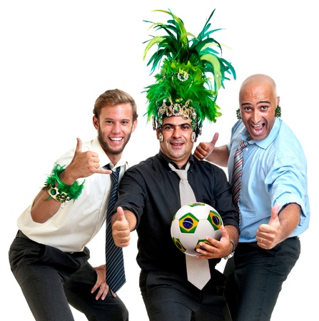 Team of businessmen with brazilian soccer ball and Carnaval colors photo