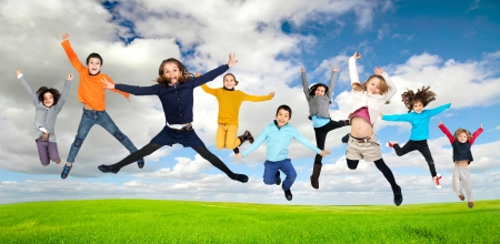 Group of children jumpng outdoors photo