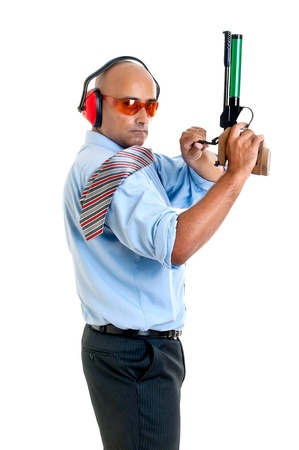 compressed air: Businessman with compressed air gun  Stock Photo