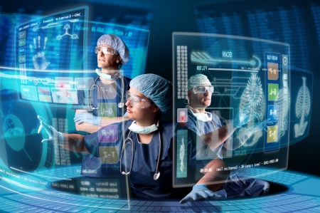 surgeon: Doctors in a research station with digital  screens and keyboard Stock Photo
