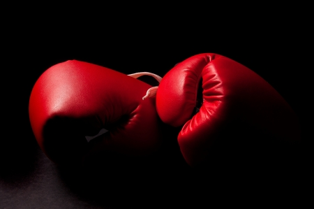 Boxing gloves against a black backgroud photo