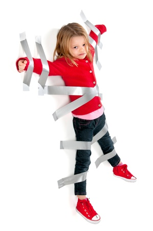Young girl tied to the wall with duct tape photo