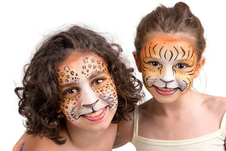 Beautiful young girls with feline painted faces, tiger and leopard