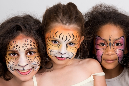 facial painting: Beautiful young girls with animal painted faces