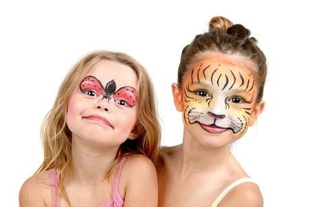 ni�os pintando: Hermosas chicas j�venes con las caras pintadas, tigre y Mariquita