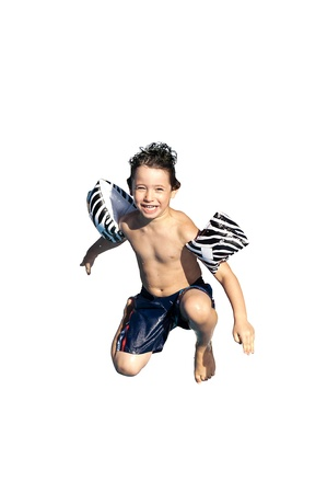 Young boy jumping in the water isolated in white photo