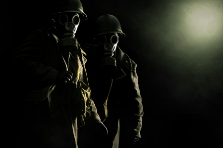 Soldiers with gas mask in a dark background Stock Photo