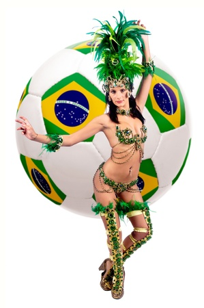 Brazilian carnaval dancer with brazilian soccer ball photo