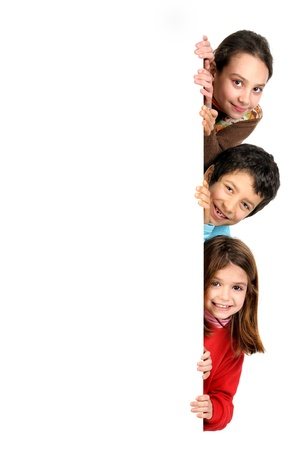 Group of children with a white board isolated in white Banco de Imagens - 21269985