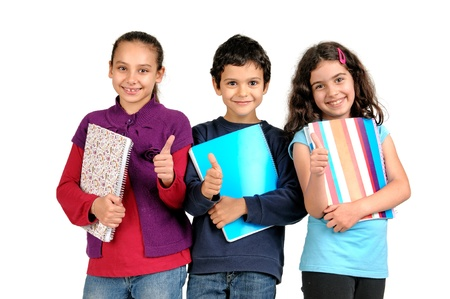 Group of children posing with books isolated in white