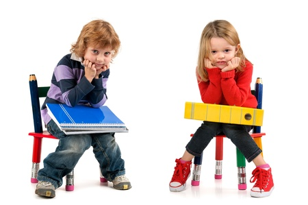 Young students seated in a chair isolated in white Stockfoto