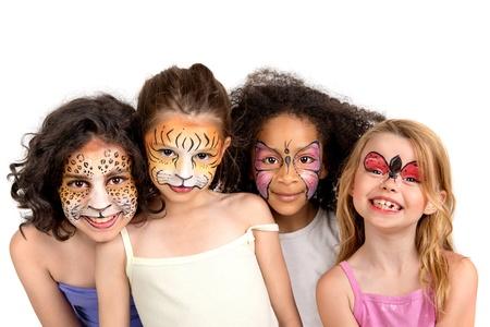 maquillaje infantil: Hermosas chicas j�venes con rostros pintados de animales