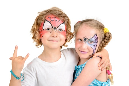 Beautiful young couple with face painted with a spider web