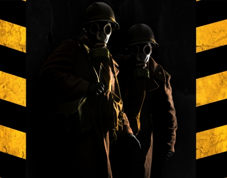 Soldiers with gas mask in a dark background photo