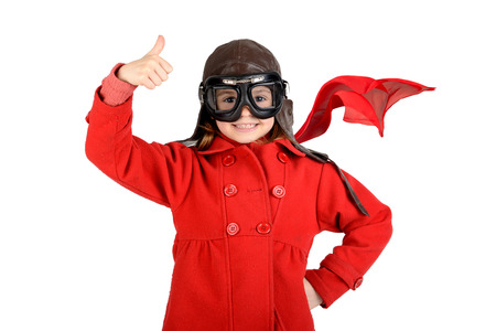 airman: Young girl with pilot goggles and hat isolated in white