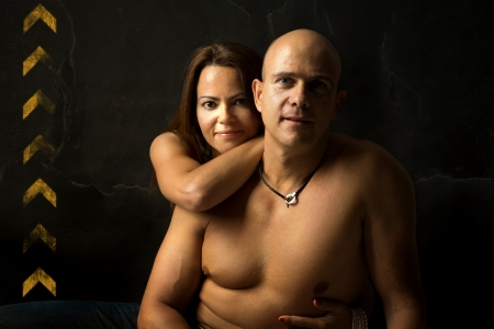 Sexy couple isolated in a black background photo