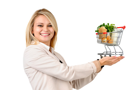 Woman with shopping cart isolated in white photo