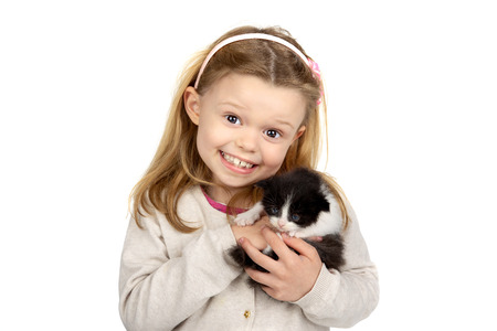pretty young girl: Beautiful young girl posing with a lovely young kitten