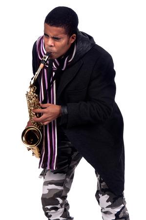 african sax: Stylish man playing the saxophone Stock Photo