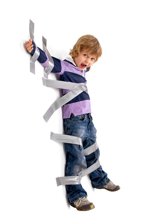 duct tape: Young angry boy glued to the wall with duct tape