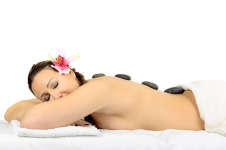 Beautiful woman in a massage at beauty spa salon.