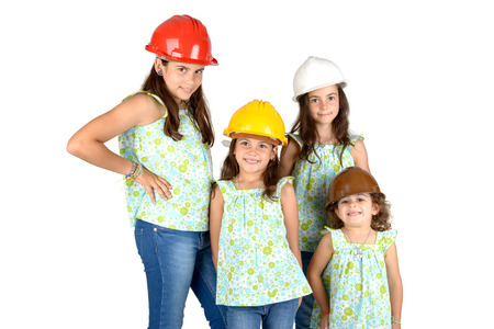 costruction: Group of young girls posing with costruction workers hats