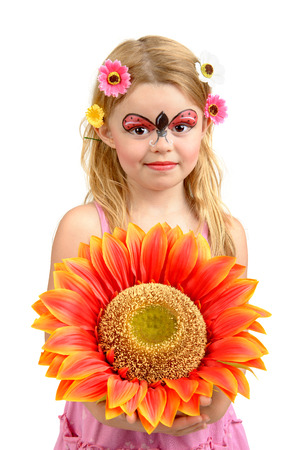 Beautiful young girl with face painted like a ladybug photo