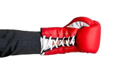 Businessmans hand with a boxing glove photo