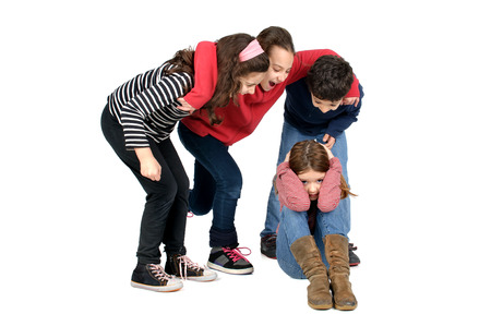 Group of children bullying an isolated child Stockfoto